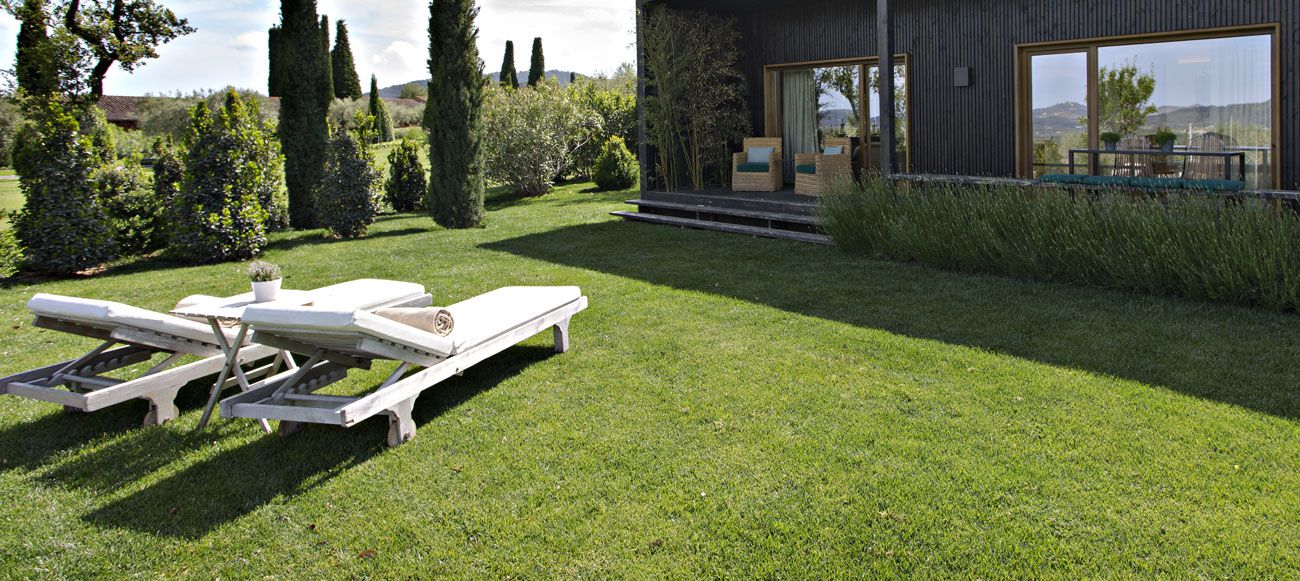 Relax and unwind in a converted Spanish farmhouse courtesy of Mas de Torrent Hotel and Spa's nature suite boasting its very own private garden.